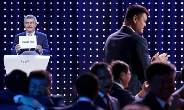IOC president Thomas Bach, left, announces Beijing as the host city the the 2022 Winter Olympics as China's Yao Ming celebrates.
