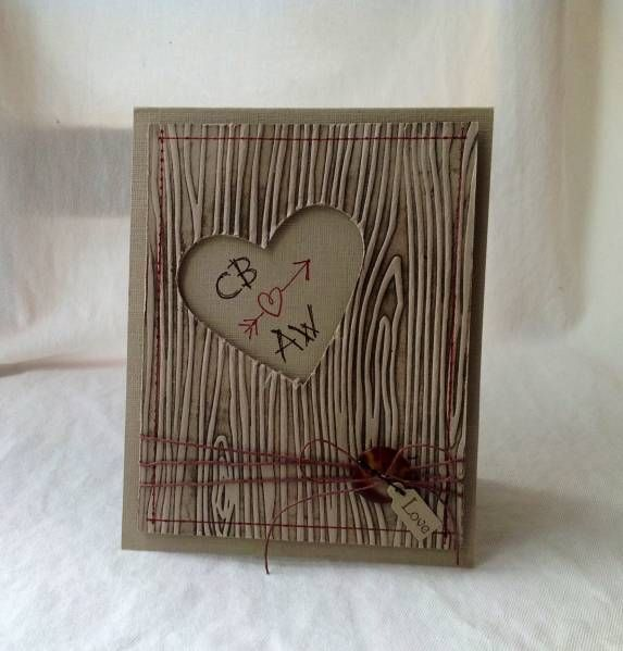 """handmade Masculine Valentine card by Weekend Warrior  ... inked embossing folder technique with woodgrain folder ... negative space heart with """"carved in the tree"""" look initials ... brown twine wrapping  ... button ... like this design ... great card for a male ... \Stampin' Up!"""