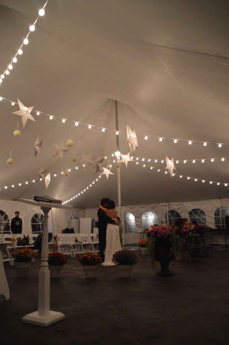 Dancing under the stars in a white event tent on the patio in the gardens at Apple Blossom Chapel and Gardens