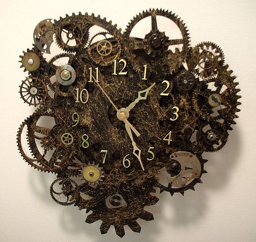 steampunk clock made from wood gears and watch parts.