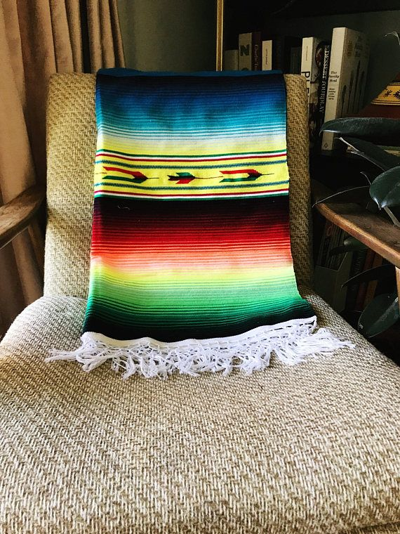 Vintage mexican saltillo serape throw, southwestern blanket, beach blanket, picnic blanket Lovely Saltillo blanket or throw Has bold colors Good vintage condition with small pulls See photos Measurements: 29 in x 63 in With fringe 29 in x 71 in