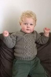 Little Taliesin sweater knitting pattern. Knit in the round with beautiful cable pattern and TWO neckline options