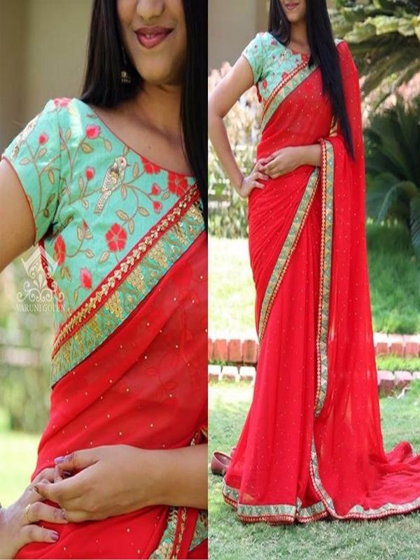 Monopolizing Red Georgette Designer Saree with Sky Blue Color Banglory silk Blouse. It Contained the work of Multi & Hand with Lace Border. The Blouse can be customized up to bust size 44