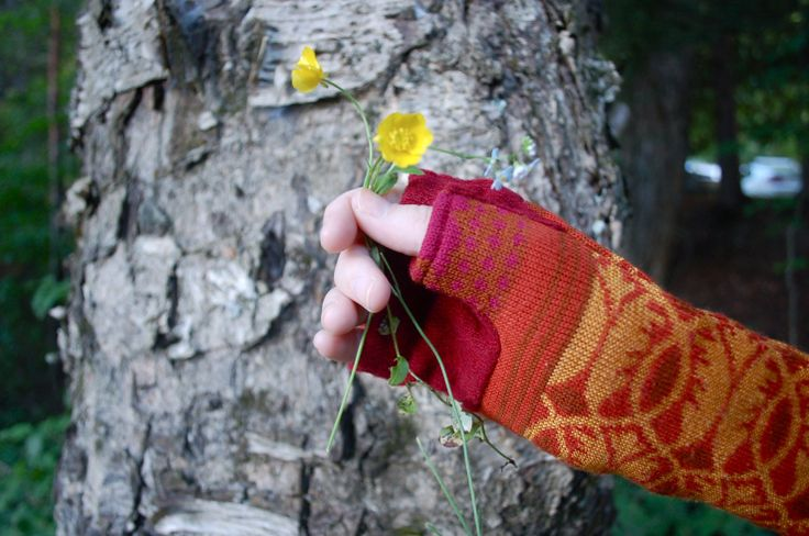 Upcycled sweater arm warmers in red, orange and yellow by Jennifer Fukushima.