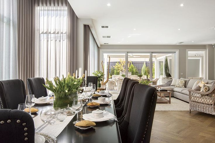 Family dining in the Brookwater display home with Classic Hamptons World of Style.