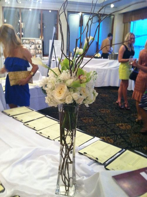 Tall centerpiece of green cymbidium orchids, ivory garden roses, spray roses, white hydrangea, white callas, lily grass and Curly Willow by Andrea Layne Floral Design (www.andrealaynefloraldesign.com)