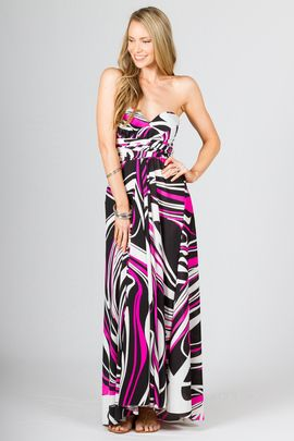 """Multi Way Wrap Maxi - Pink Graphic by Paper Scissors Frock. This clever design can be worn in endless styles.  It really is up to your imagination.  We have shot it in a few styles to give you some ideas. Made from high quality ITY polyester.  Pictured model is 5'9"""""""