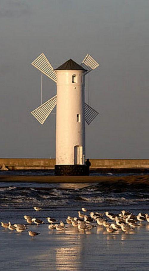WIndmill/Lighthouse entry to the port of Świnoujście, Poland.