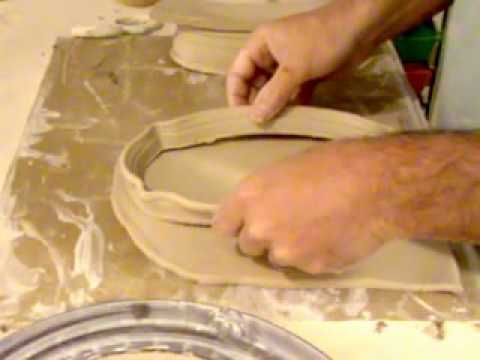 Classic American Butterdish thrown on the wheel using a double wall throwing method, some altering and some handbuilding. He leaves some details out toward the end, however still and excellent tutorial. - Senjen