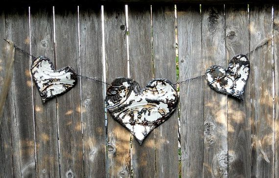 Ceiling tin heart garland.