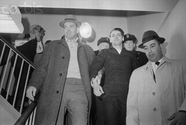 """Police Escorting Albert DeSalvo  February 25, 1967 - Confessed Boston Strangler Albert DeSalvo (c) is led from a press  conference at the Lynn police station after his capture in a West Lynn uniform store.  Wearing navy-type garb, DeSalvo said he """"didn't bother anybody."""" His arrest came  some 30 hours after his escape from Bridgewater State Hospital."""
