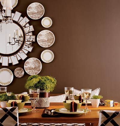 Great display of plates around the mirror.  #mirrors, #plates, #wall art,
