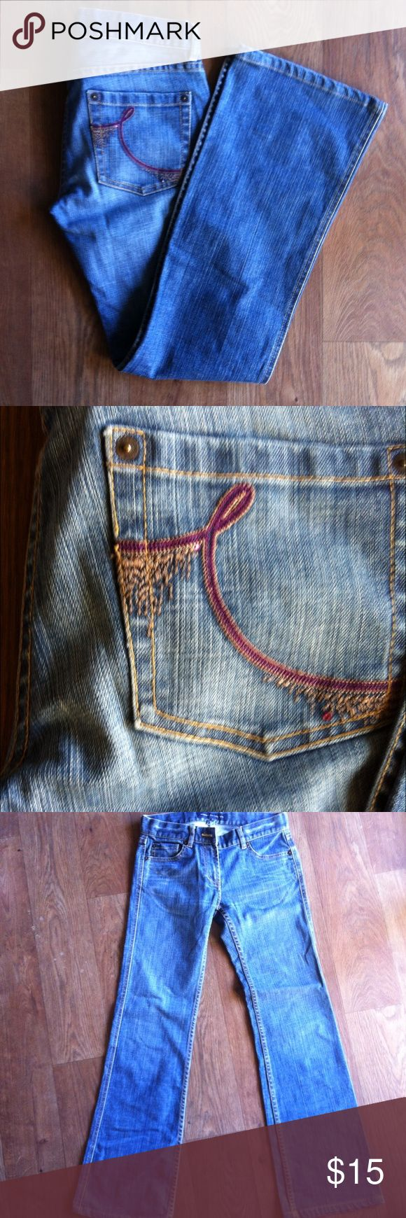 French Connection Jeans Size 4 bootcut French Connection Jeans with decorative purple stitching and rhinestones on back pockets. Great condition, no noticeable wear. French Connection Jeans Boot Cut