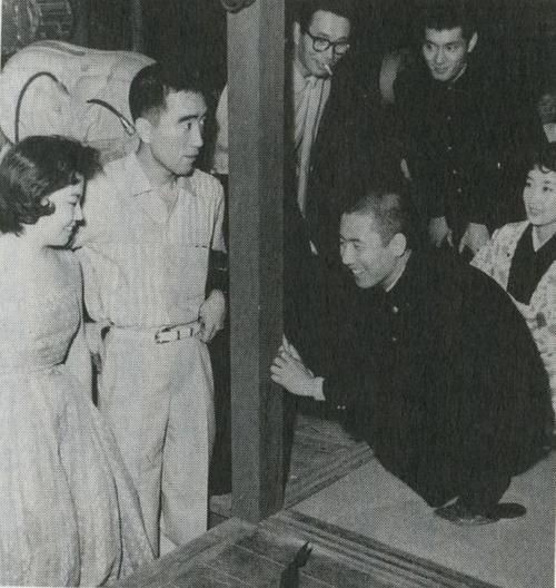 Yukio Mishima and his wife visiting the set of Enjo with actor Raizo Ichikawa and Tatsuya Nakadai, 1958