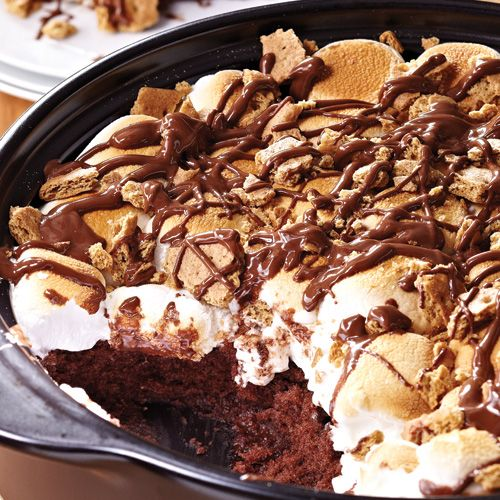 S'more Cake  - The Pampered Chef® 3   milk chocolate candy bars (1.55 oz or 43 g each), broken into squares 1 2/3 cups (400 mL) devil's food cake mix 1   egg 1 container (8 oz or 250 mL) sour cream 1 bag (10 or 300 g) regular-size marshmallows or 4 cups (1 L) mini marshmallows 3   whole graham crackers, coarsely chopped