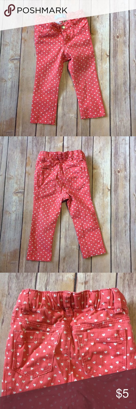 Old Navy Skinny Jeans Orange & white skinny jeans with a heart pattern. Has an adjustable waist. 5 pocket design. VGUC for mild wash wear. 111709 Old Navy Bottoms Jeans