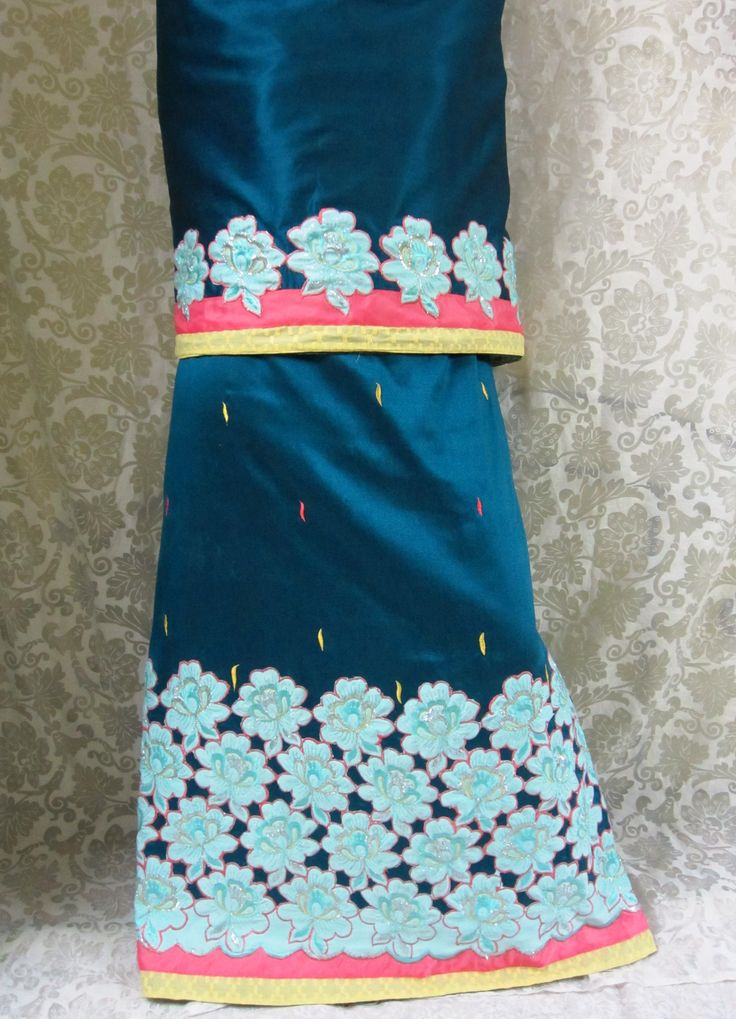 Description - Persian blue rida designed with cut work, appliqued, sky blue colored flowers, panels and all over embroidered petal motives for a stylish evening/occasional wear !