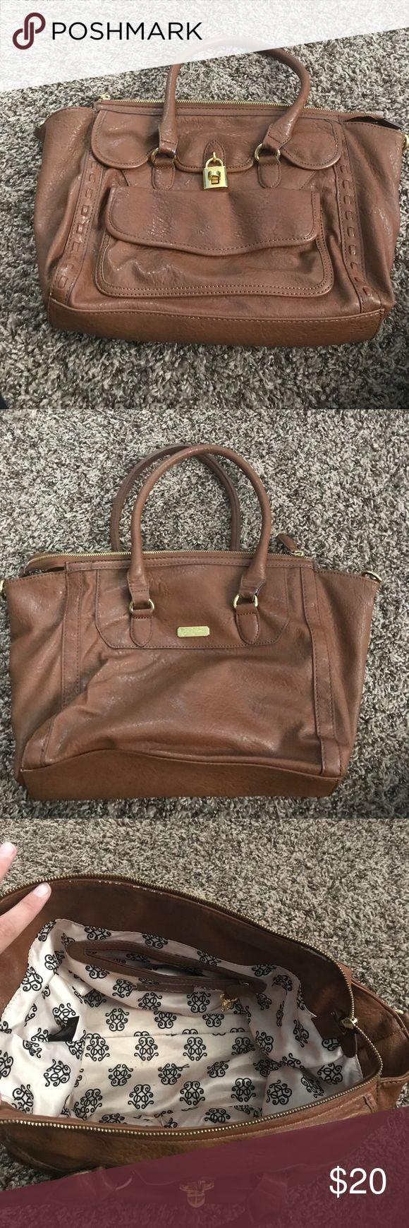 Jessica Simpson purse Gently used Jessica Simpson purse. Little bit of wear and tear on inside under zipper. Multiple pockets. Jessica Simpson Bags Satchels