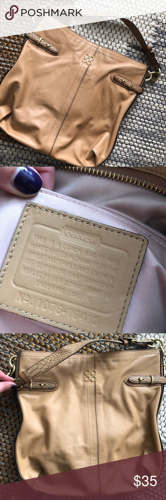 Coach Beige Shoulder Bag Beautiful all leather COACH shoulder bag! Exterior in fantastic condition, small ink stain (pictured) inside. Snakeskin and brushed gold trim! Great everyday bag. Coach Bags Shoulder Bags