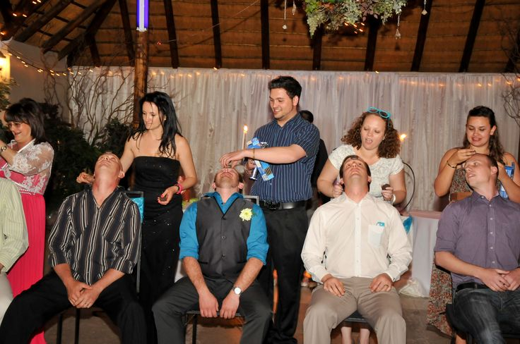 our second wedding game was a minute to win it game. move the Oreo from your forehead to your mouth with your face