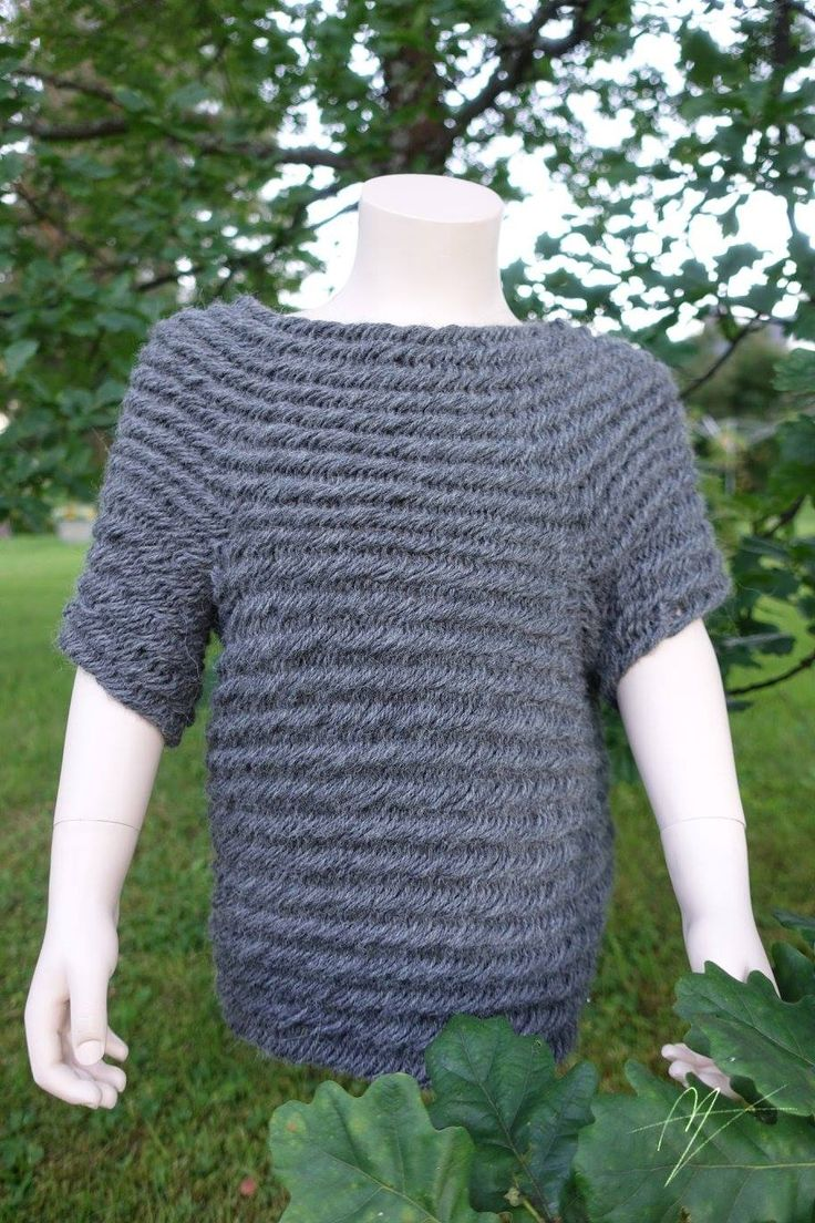 Needlebound / nalbound sweater, made with 222 grams of Alpaca Sport yarn, using own mystery stitch, by Eva Bolinder.  Started from in the middle, ish. Then continued downwards to create armhole loops, and bottom of sweater, then sleeves finished and lastly collar. Posted 2016-07-19 [in English] in Nålbinding : stitch-along sweater group  @ Facebook. Please see link for album! ~ For more info [in Swedish & English], please see blog entry here: http://nb.miravisu.net/troja-sweater-1/