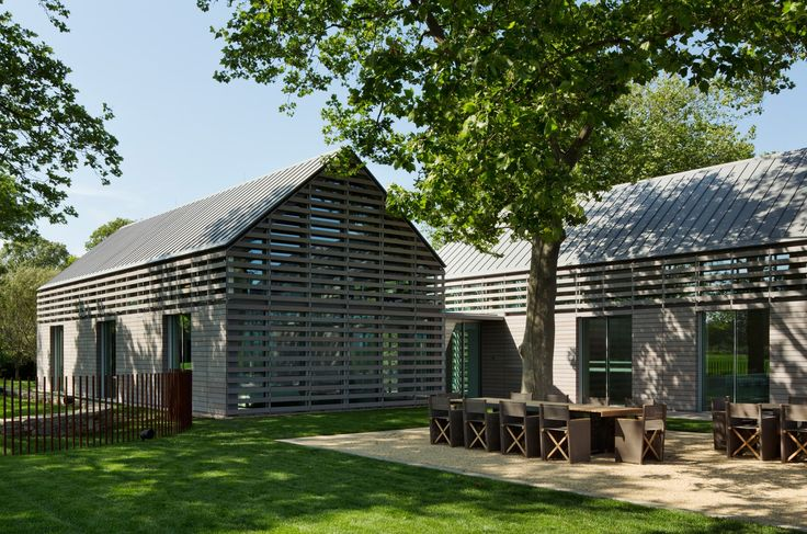 This guest house was designed to serve as a luxury reprieve for visitors to an adjacent traditional estate in the Hamptons. Two simple gable-shaped volumes o...
