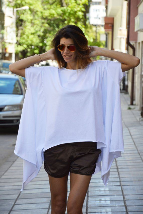 541bb47f981 White asymmetrical tunic for people who like the free style.  Comfortable,practical, suitable for walking , dinner, party.. With its  freedom, the model ...