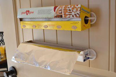 Mounting foil & wrap inside cabinet door using plastic hooks.