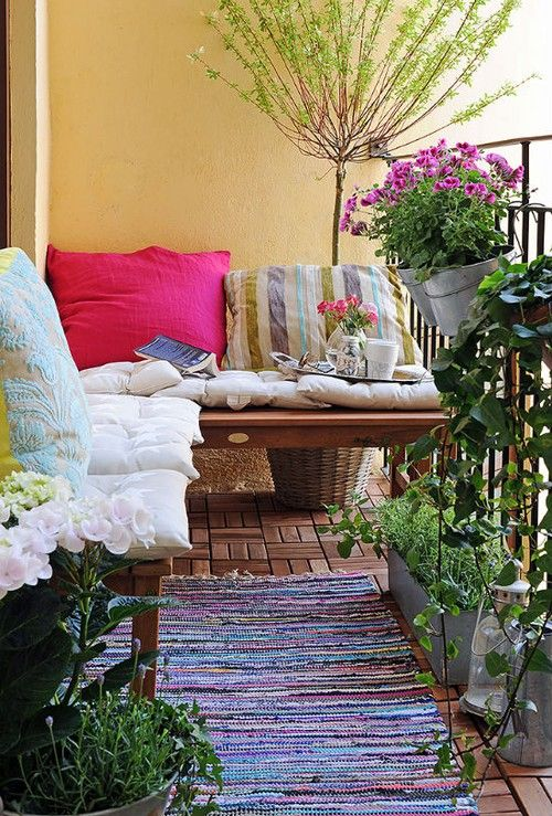 this is a balcony but it would work for a cozy space on the ground as well.. Comfy outdoor space.