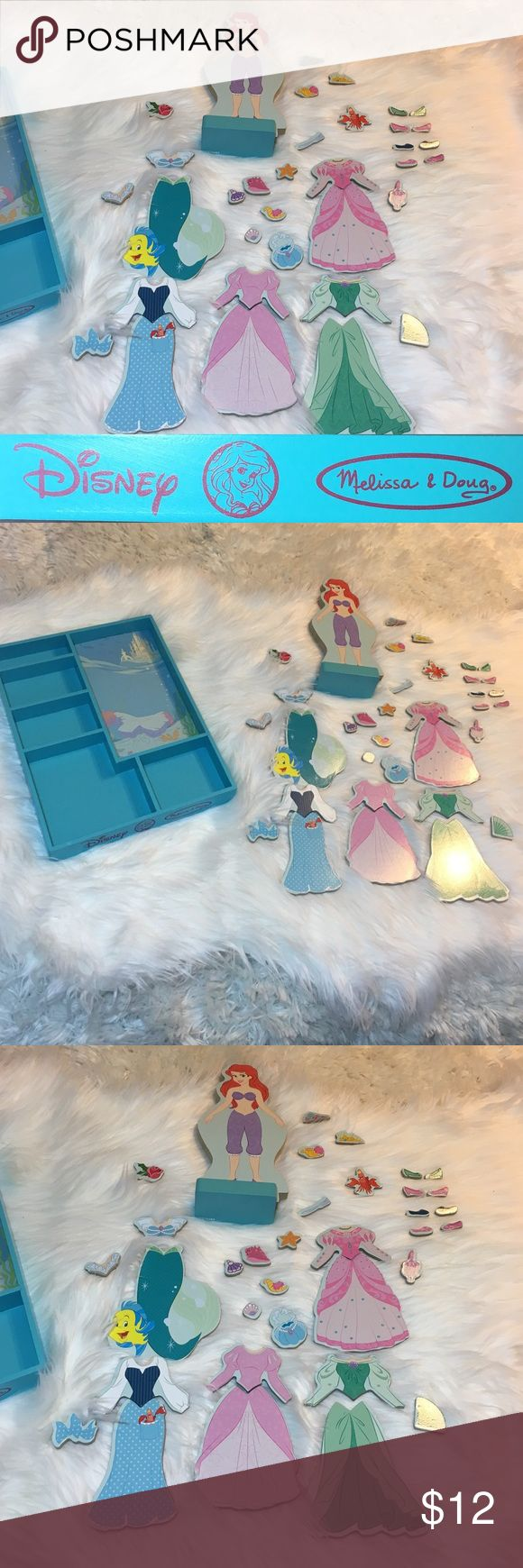 Melissa & Doug Little Mermaid Ariel Wooden Doll Walt Disney  Ariel wooden magnetic dress-up doll. Mix and match the magnetic pieces to tell the tale of the little mermaid or create your own fashion story with sturdy wooden pieces in coordinating designs they are countless stylish combinations. Not missing any pieces and can be considered new in box because when this was sold it just had plastic over the container. Originally bought at Carters (baby Store). Feel free to ask questions and make…
