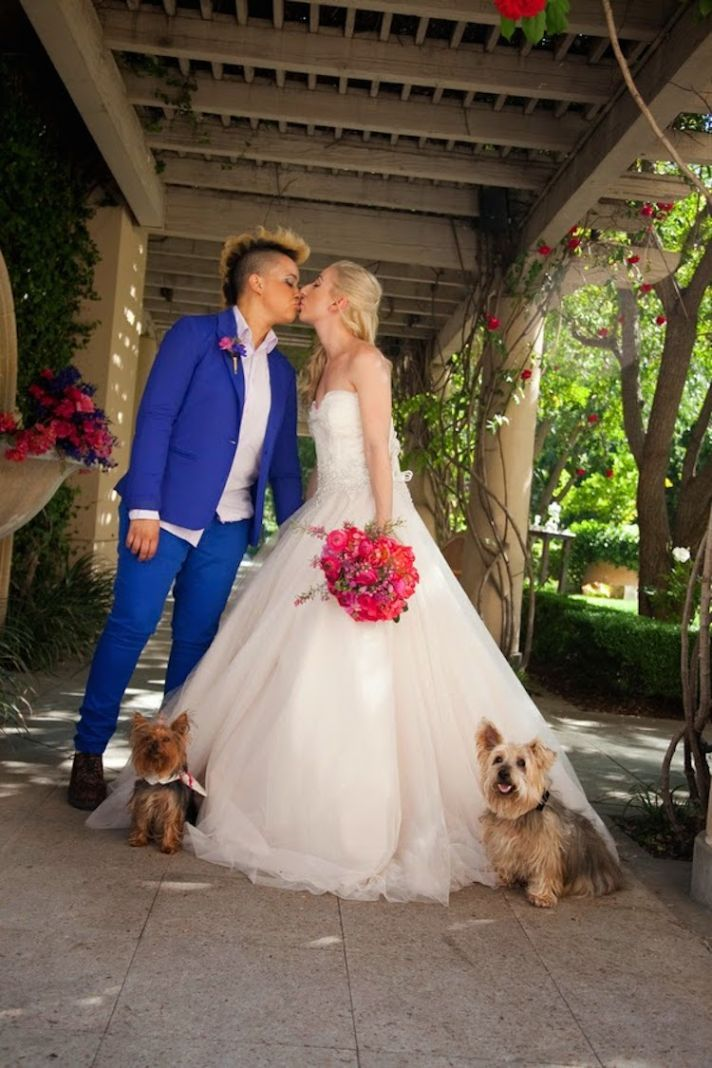 Two Brides: one in a modern blue suit and the other in a gorgeous princess gown