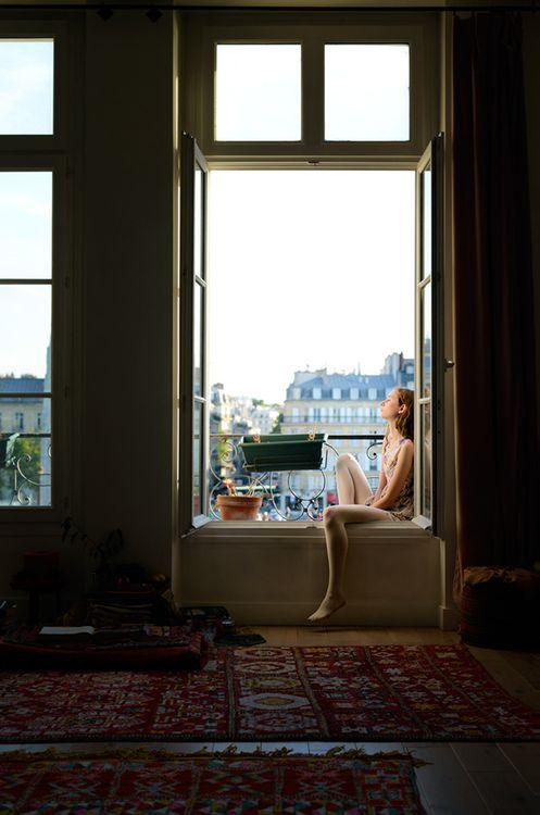 Observar los tejados de la ciudad desde mi ventana