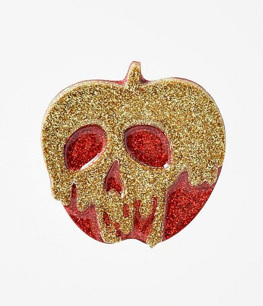 Pick your poison, darling! A glittering resin brooch cast in a red apple shape with deadly golden poison dripping over the apple in a skull silhouette. Secured by a safety bar pin for the perfect bite to your ensemble.<br />Available while supplies last.