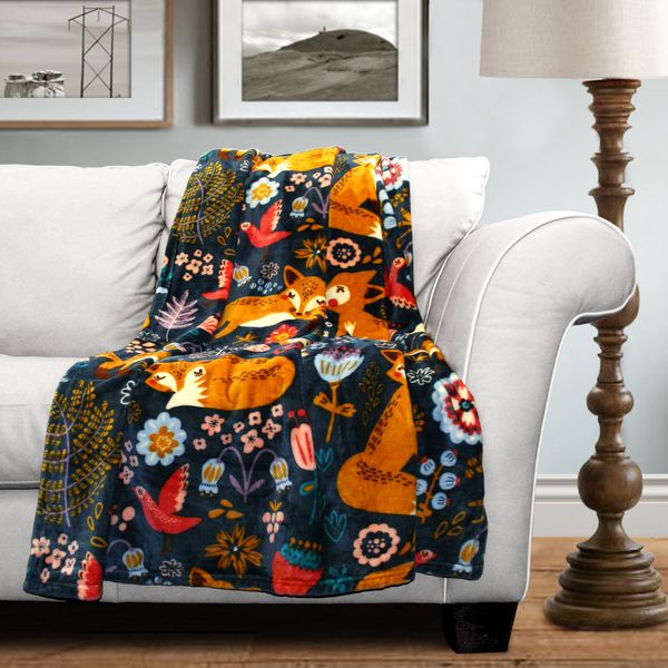 Mix up your style with this fun and decorative Lush Decor Pixie Fox Fleece Throw. Made of fleece, this multicolored blanket showcases a decorative wildlife design. Snuggle up in style with this entert