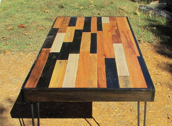 Each table is very unique and hand crafted from various types of wood. This table is stained in strips of Natural and Ebony, and coated with 3 coats of protective varnish for a smooth wipe-able finish. Hairpin legs are included and shipped separately.  Measurements: 5 X 30 x 30  For more styles, click here:  https://www.etsy.com/shop/SereneVillage?section_id=16842370&ref=shopsection_leftnav_2