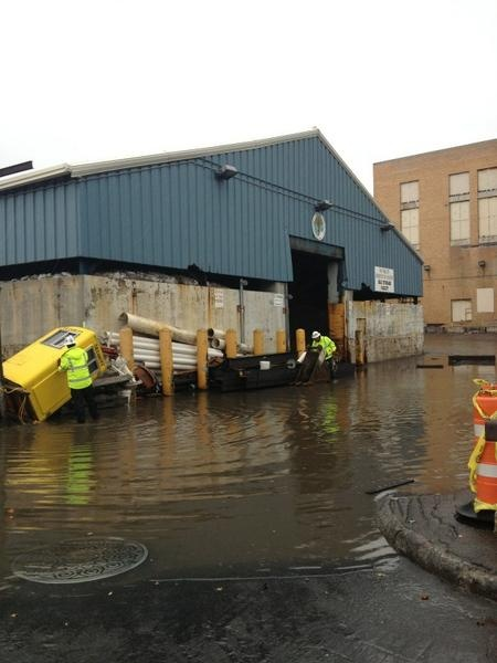 NYC Dept of Sanitation salt storage building already flooding next to Hudson River. #Sandy #nyc