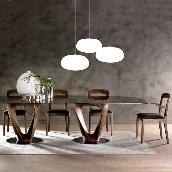 The exquisite Mobius dining table, made in Italy by Pacini e Cappellini, will complement both contemporary and traditional settings. The solid walnut or ash base is