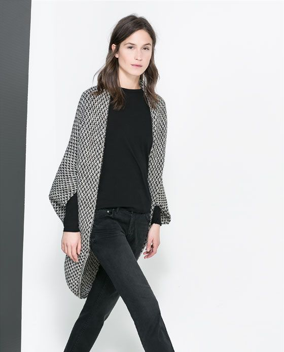 Digging the pattern on that drapey sweater. It adds a little zaaz to an an entirely black and white ensemble. - EH