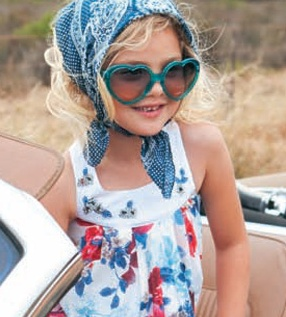Lapin House Children's wear. This styling is unified through colour, pattern and line. The sunglasses are the emphasis.