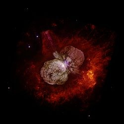 The Homunculus Nebula is an emission nebula surrounding the massive star system Eta Carinae. It is some 7,500 light-years away, and appears in the Eta Carina Nebula in the constellation Carina