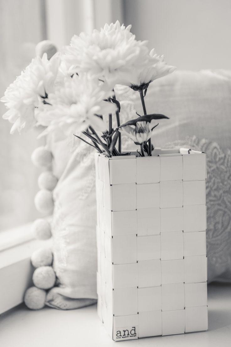Woven basket made of recycled window blinds. www.annanygard.com Photo: Johanna Karttunen