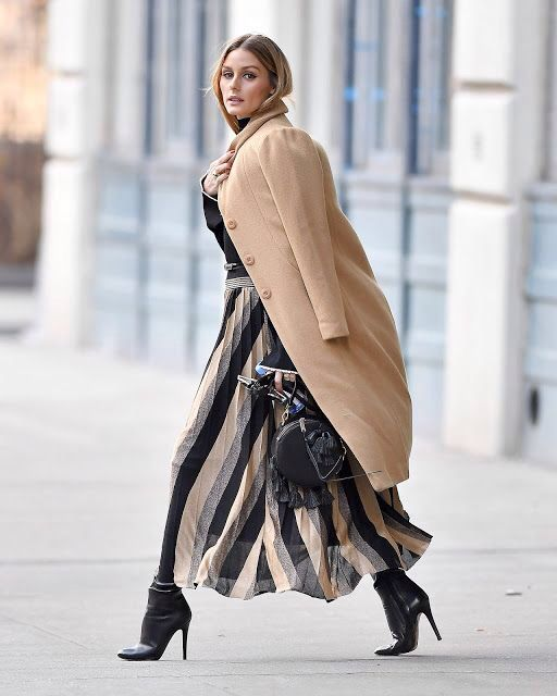 Olivia Palermo in camel trench with pleated skirt