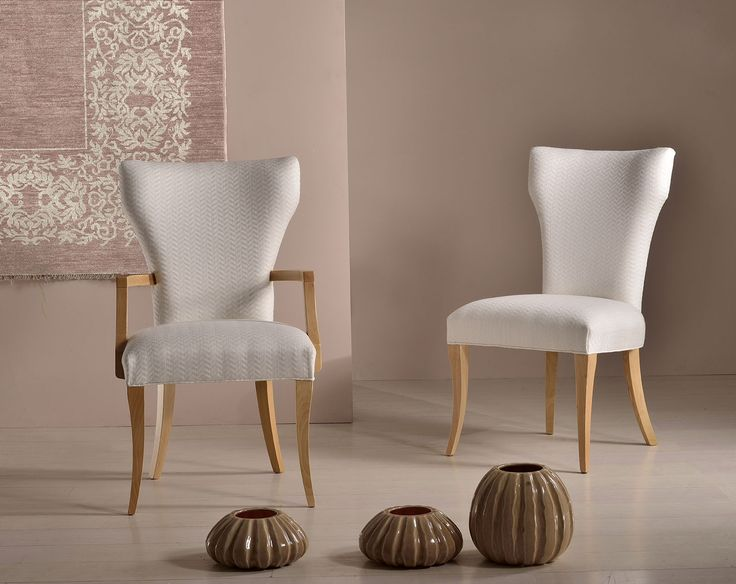 Calla. Chair and armachair by new Venetasedie luxury collection. White fabrics, natural wood, fine materials and details in a beautiful furnishing element creating fine living.  Luxury interior design by Veneta sedie