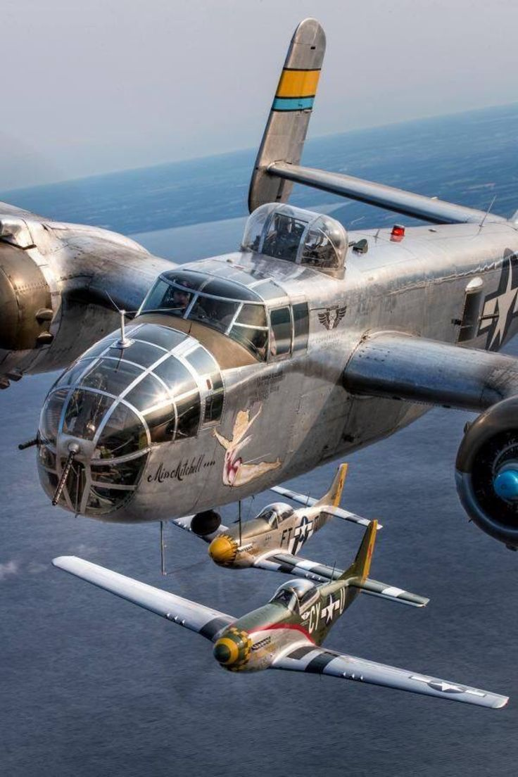 A B-25 Mitchell with two P-51 Mustang little friends