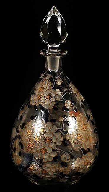 Delvaux Perfume Bottle, ca. 1920...clear blown glass bottle with ground and polished pontil bottom, decorated with black, white and gilt blossoming branch overall decoration.