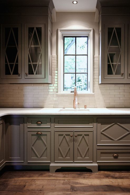 Gray Kitchen Boasts Gray Cabinets With Glass Front Upper Cabinets Accented With Diamond Mullion