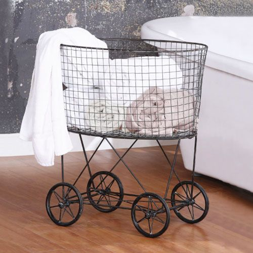 Olga's Metal Laundry Basket with Wheels | dotandbo.com. Cute to put dirty clothes in bedroom just roll into laundry room.
