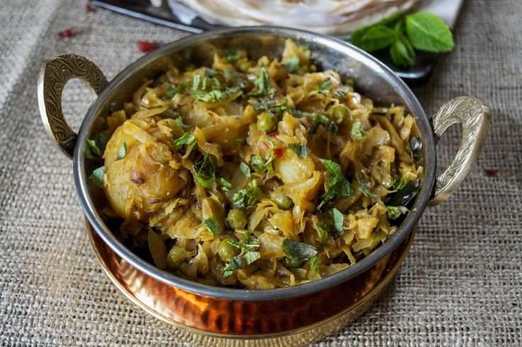A simple yet delicious bengali dish mede with cabbage, peas and potatoes and flavoured with spices and garam masala.