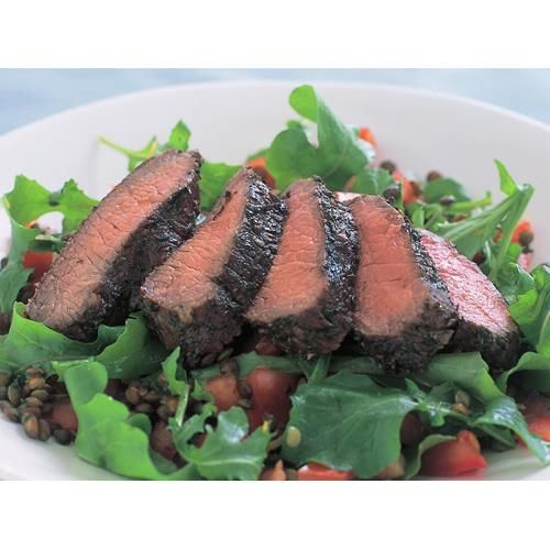 Marinated lamb backstraps with lentil and rocket salad recipe - By Australian Women's Weekly, Puy lentils are from the region of the same name in France. Very small and particularly fast cooking, they have a delicate, almost nut-like flavour that lets the marinated lamb backstrap stand out as the star of the show.