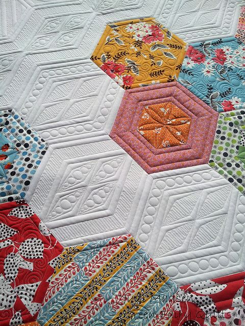 Pam's Science Fair quilt finished.  Wow, what amazing quilting.  New way to make hexagons stand out.